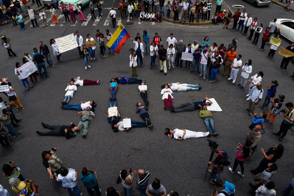 Dire conditions in Venezuela have forced the medical community to resort to protests that would have previously been inconceivable.  Photograph courtesy of Federico Parra / AFP / Getty Images.