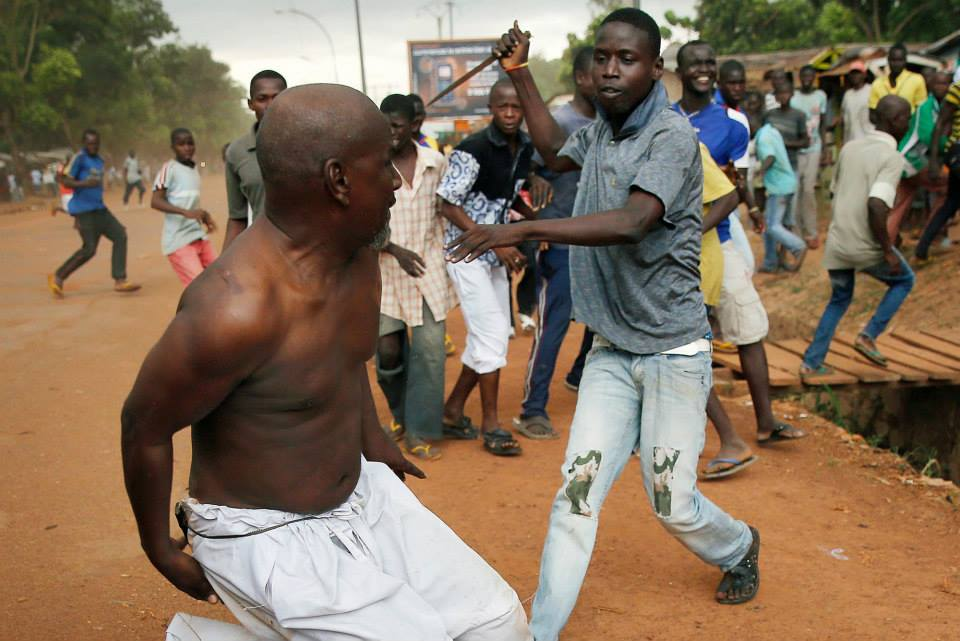"A Christian attacks a Muslim in the Central African Republic. The CAR has witnessed the displacement of 1 in 5 of its citizens and is now reportedly in stage 7 (""Preparation"") of 10 in the 10 stages of genocide. Photo by Jerome Delay, AP."