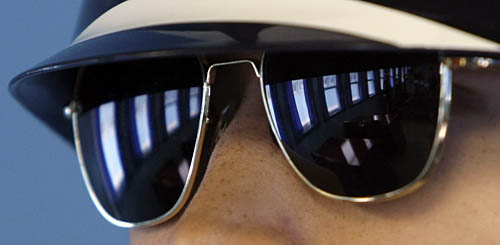 Reflection of a meeting room on a South Korean soldier's glasses.  This meeting room is in the DMZ, the dividing line between North Korea and South Korea.  Since their armistice in 1953 the two countries have technically remained at war.  AP Photo / Lee Jin-man
